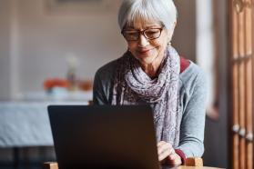 Woman looking at computer smiling