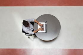 Overhead shot of man sitting in front of a laptop