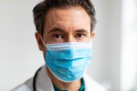 Physician wearing facemask