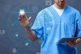 Physician using tablet and digital app for caregiving.