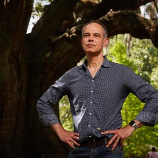 Photo of Nigel Girgrah, MD, standing in front of a tree