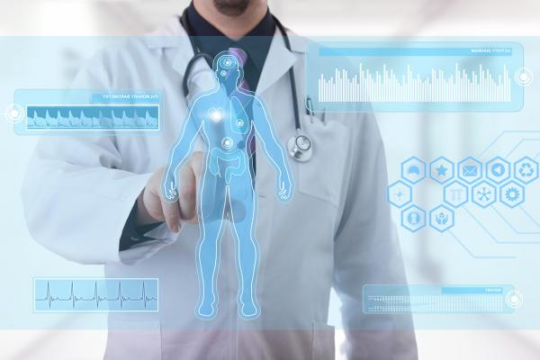 Augmented intelligence (AI) hologram and physician pointing to screen displaying graphs