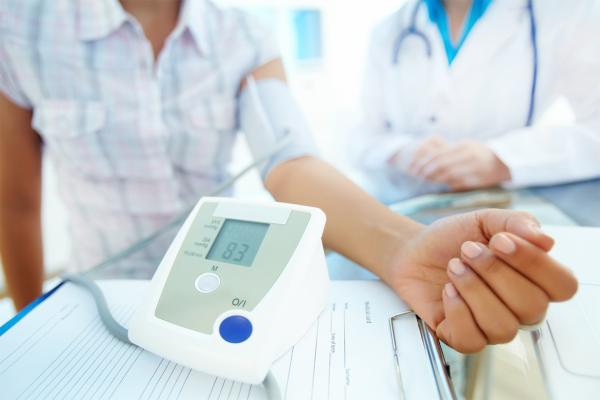 Patient in doctor's office taking blood pressure