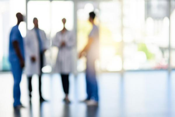 Blurred image of a group of physicians standing together