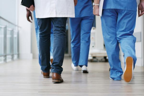 Group of physicians walking down a corridor