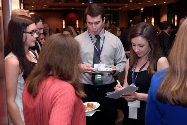 A group of medical students have snacks at the MSS Annual Meeting.