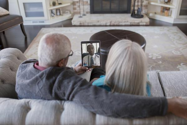 Couple has virtual visit from doctor in their home.