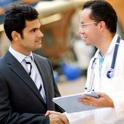 Man in a suit and physician shaking hands