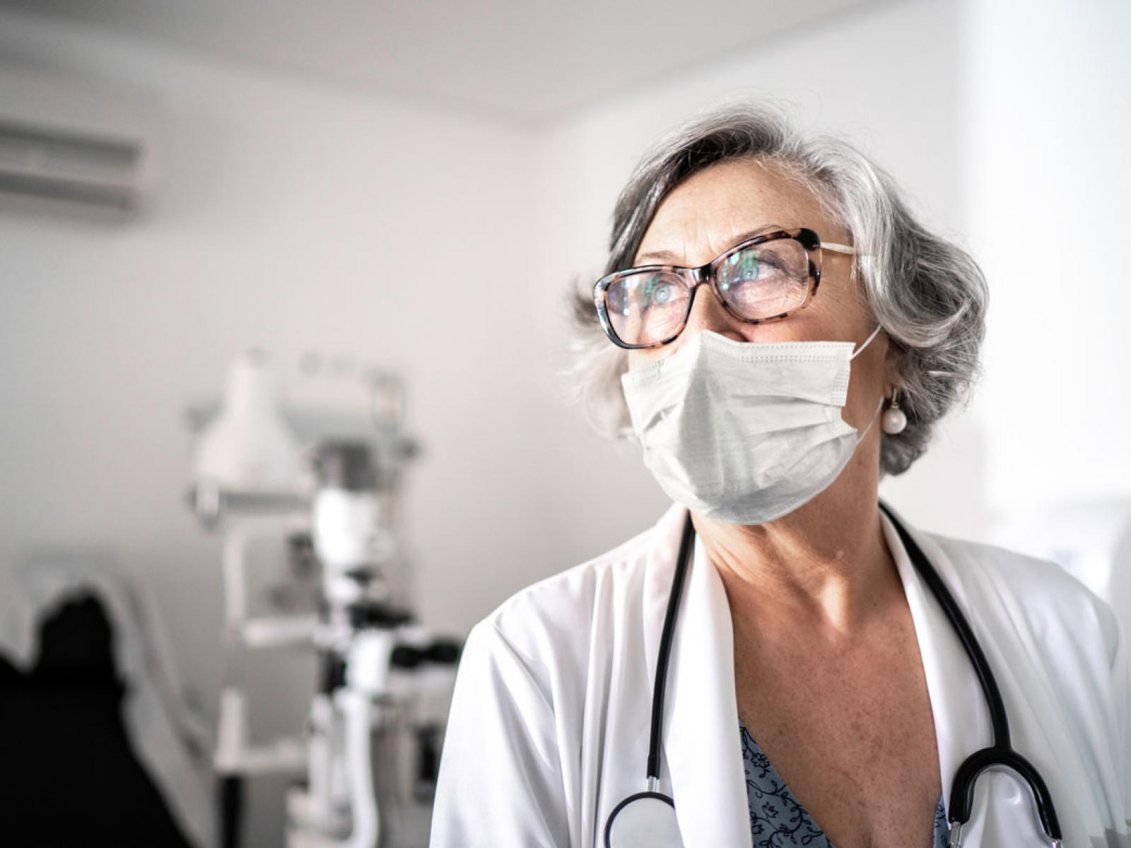 Woman physician wearing a face mask