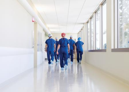 Physician team walking down a hospital hallway