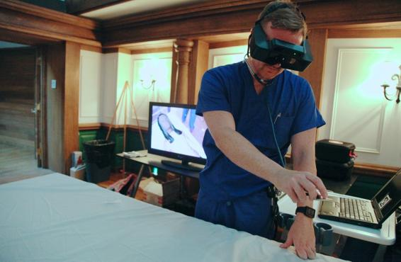 Doctor using a virtual reality patient simulator.