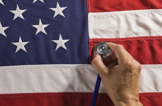 Person holding a stethoscope against American flag