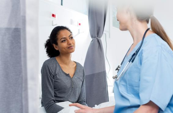 Women physician talking to patient