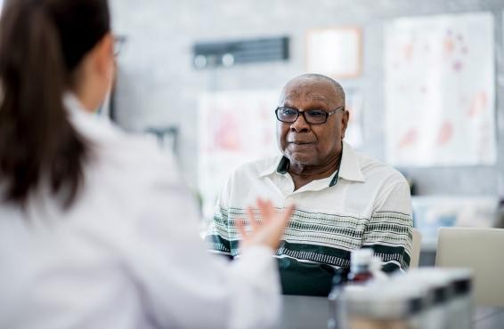 Doctor talking to elderly man