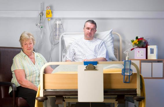 Family members sitting at the bedside of a patient