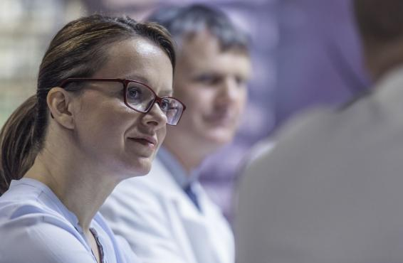 Two physicians listening during a group conversation
