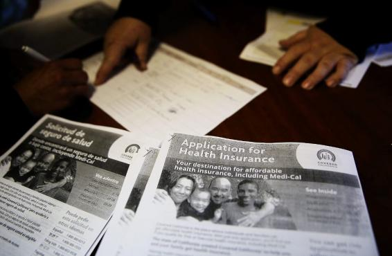 Health insurance signup forms on a desk