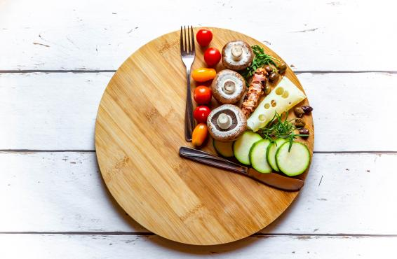 Round cutting board with healthy food