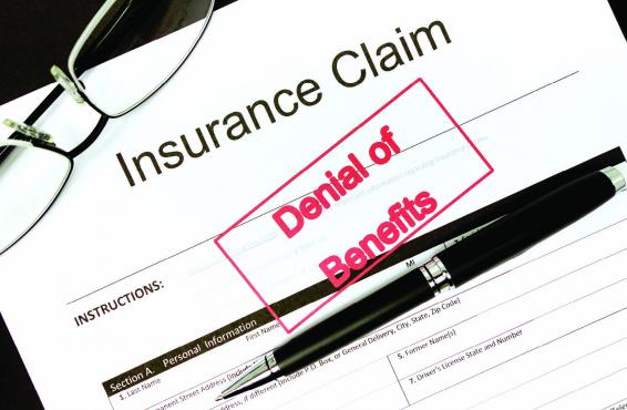 "Insurance claim stamped with ""Denial of Benefits"""
