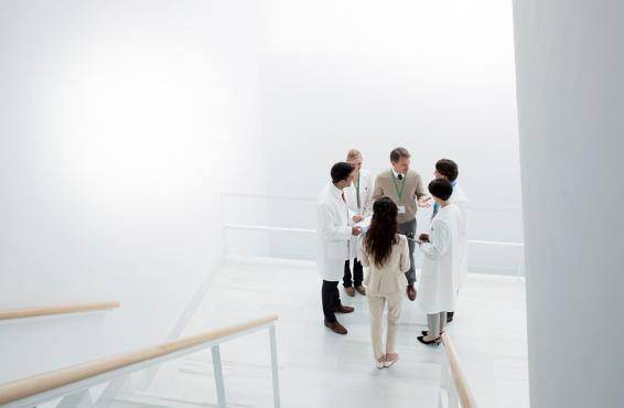 Group of physicians talking in a stairwell