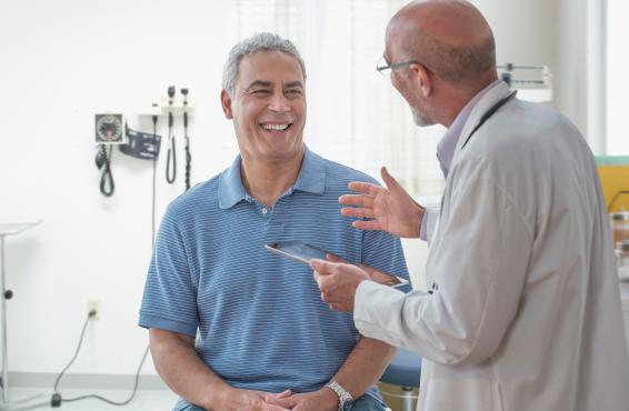 Physician talking with a smiling patient