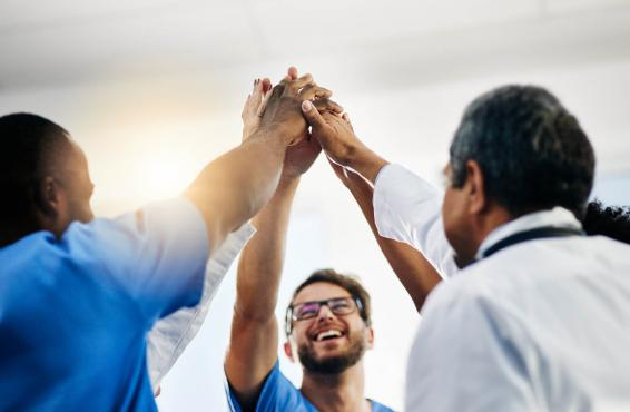 Medical professionals give group high fives