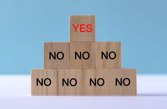 Tier of wooden blocks with the words yes and no.