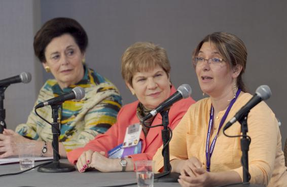 Three physicians speaking at an education session