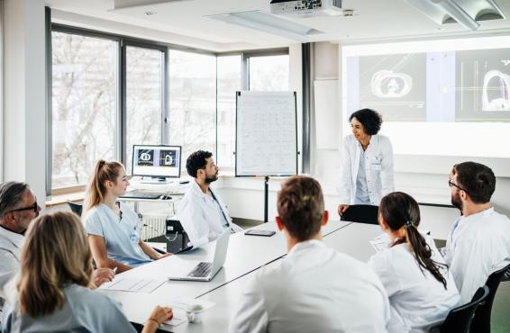 Female doctor presenting to a group of physicians