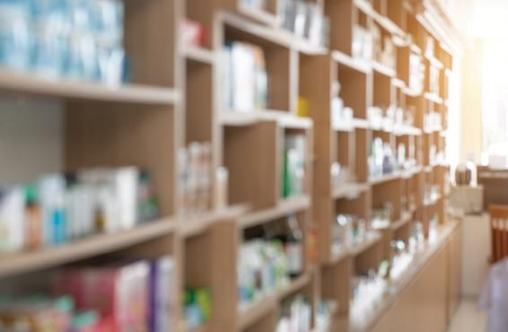 Blurred photo of pharmacy shelves