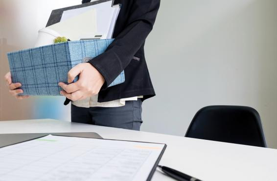 Person holding box of office supplies