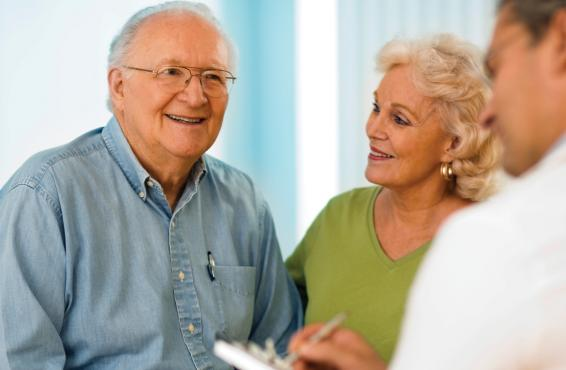 Smiling elderly man in doctor's office