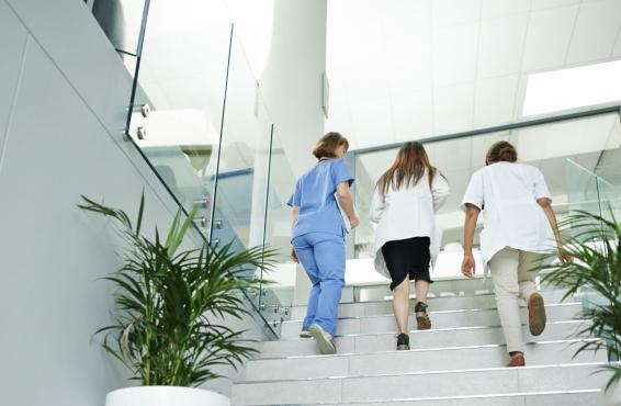 Group of physicians going up the stairs