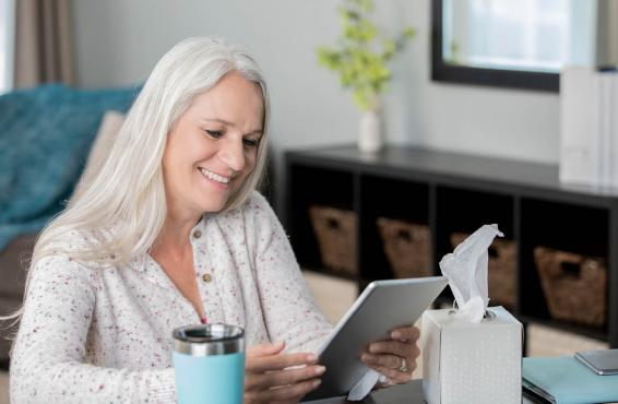 Smiling woman reading tablet