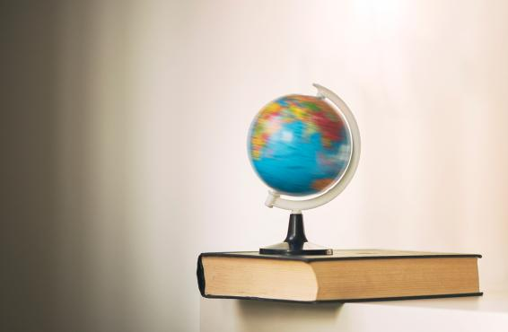 Spinning globe on a book