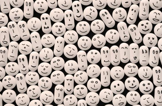 Pills with drawn smiling faces