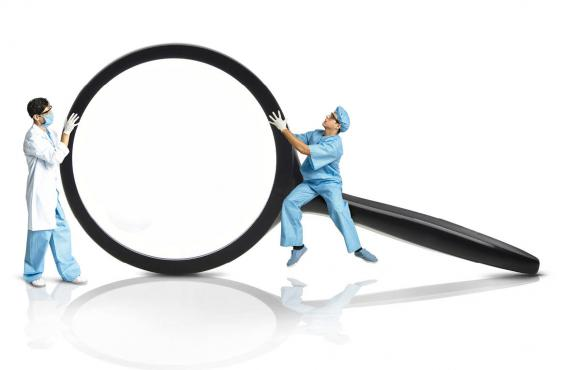 Graphic of two physicians holding a large magnifying glass
