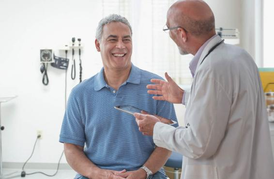 Smiling patient with physician