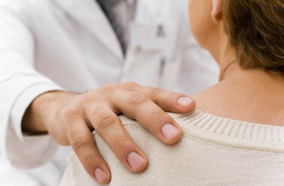Doctors hand on patient shoulder