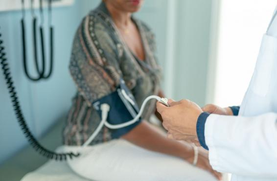 Patient having blood pressure measured in physician office