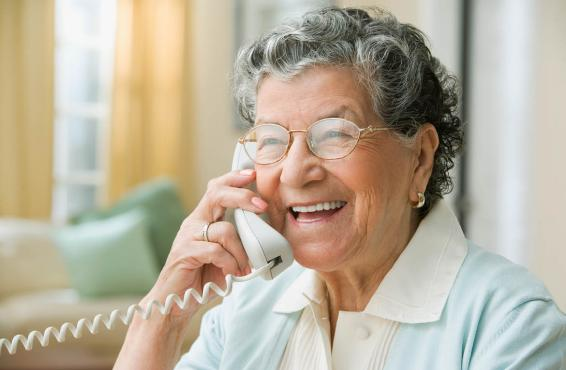 Smiling woman speaking on telephone