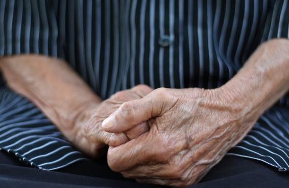 Close-up photograph of a senior's clenched hands