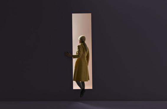 Abstract photo image of a woman walking through a door.