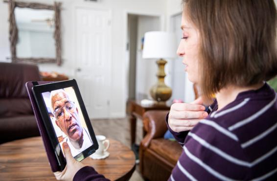 Person consulting a physician via a tablet