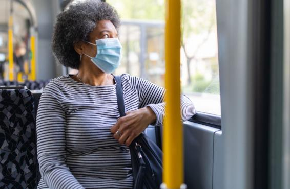 Person on a bus wearing a face mask