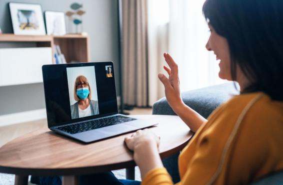 Patient consulting with a physician via webcam