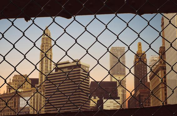 Chain link fence with cityscape