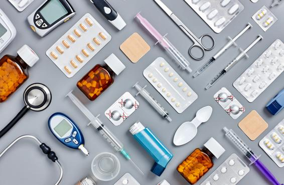 Variety of medications and medical instruments arranged in a patterned grid.