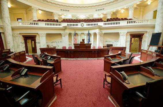 Legislature room showing podium and desks