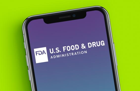 Cell phone with U.S. Food & Drug Administration (FDA) text on the screen